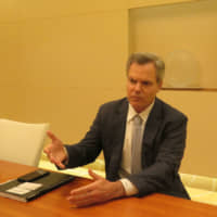 MGM Resorts International head Jim Murren speaks to The Japan Times in Osaka recently about plans for an integrated casino resort complex. | MGM RESORTS INTERNATIONAL