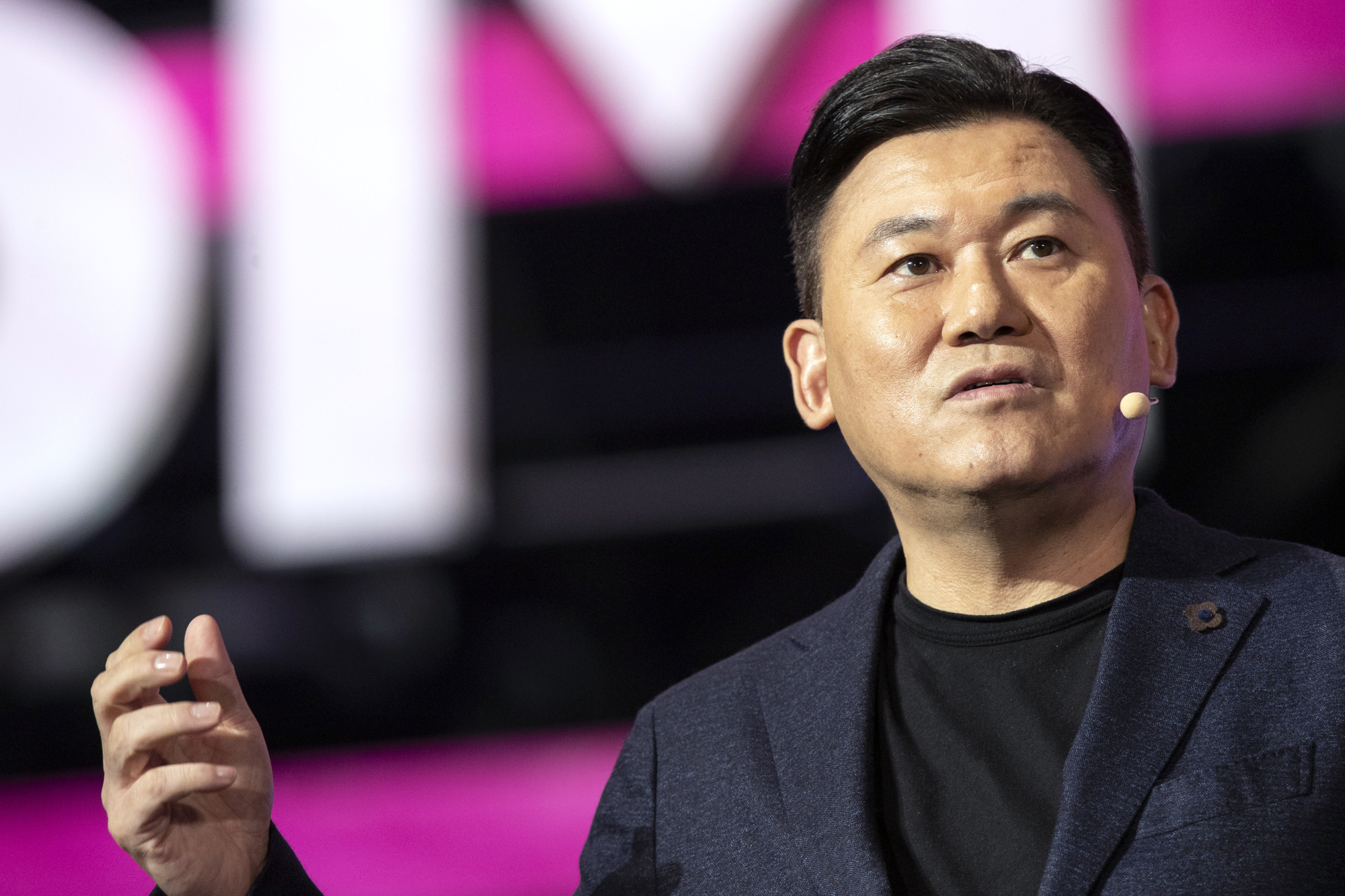 Hiroshi Mikitani, chairman and CEO of Rakuten Inc., speaks at the Rakuten Optimism conference in Yokohama on Wednesday. The business conference focusing on 5G innovation will end on Saturday. | BLOOMBERG