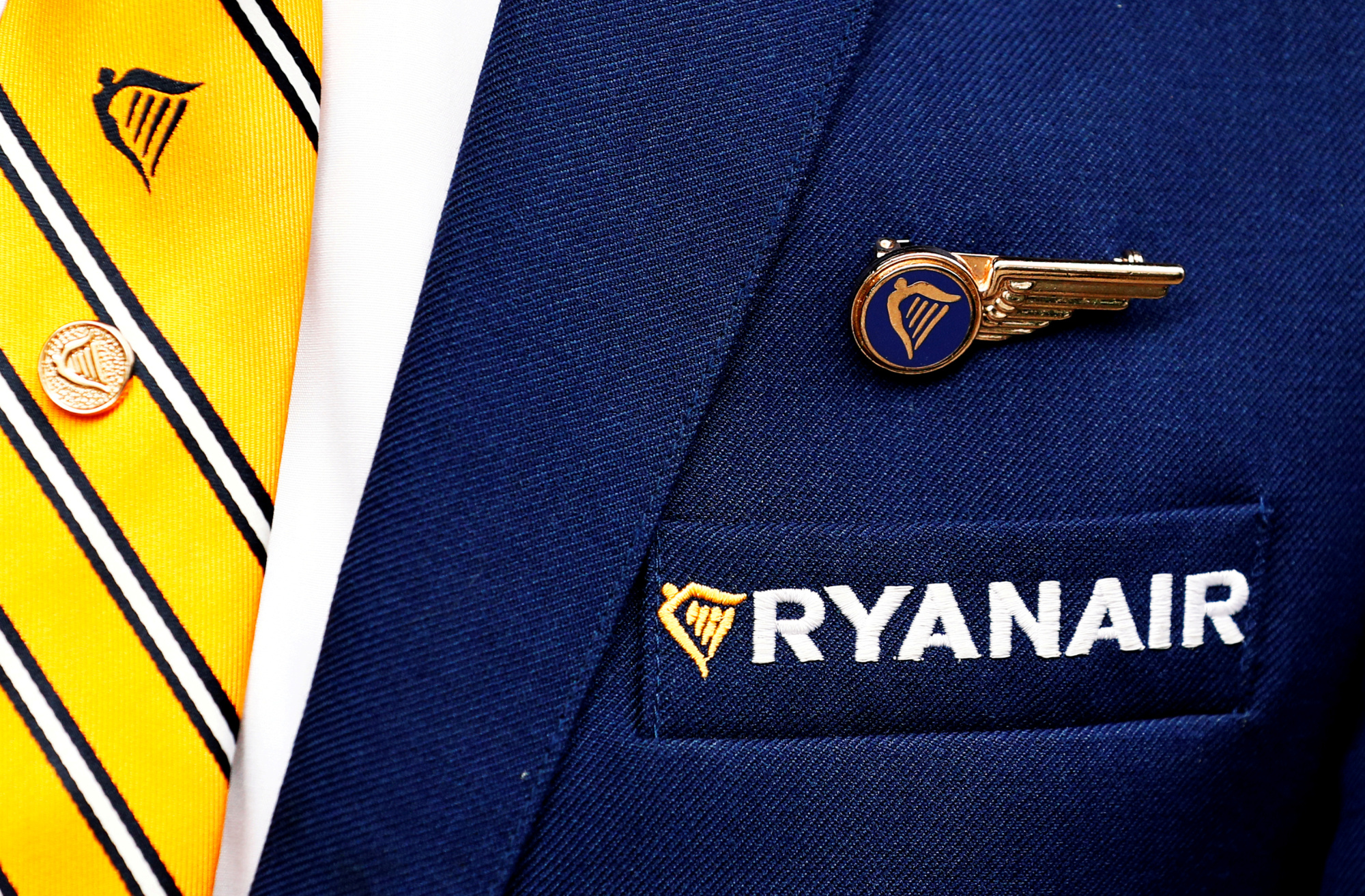 The Ryanair logo is pictured on the the jacket of a cabin crew member ahead of a news conference by Ryanair union representatives in Brussels last September. | REUTERS