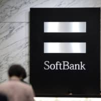 SoftBank's Vision Fund is investing $110 million in Energy Vault, a Swiss startup that's using cranes and concrete to store energy. | BLOOMBERG