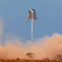 SpaceX's Mars Starship prototype Starhopper hovers over its launchpad during a test flight in Boca Chica, Texas, Tuesday. | REUTERS