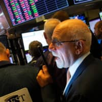 Wall Street slides on geopolitical and recession fears