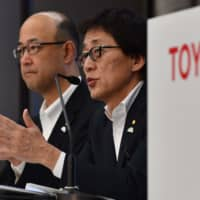 Toyota Motors Executive Vice President Moritaka Yoshida (right) speaks beside operating officer Kenta Kon at a news conference to announce first-quarter financial results at the company's Tokyo headquarters on Friday. | AFP-JIJI
