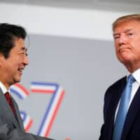U.S. President Donald Trump and and beeming Japanese Prime Minister Shinzo Abe hold a bilateral meeting during the G7 summit in Biarritz, France, Sunday.   REUTERS