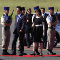 Prime Minister Shinzo Abe and his wife, Akie, arrive at the airport in Biarritz, France, on Saturday, the first day of the Group of Seven summit. | AP