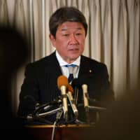 Economic revitalization minister Toshimitsu Motegi speaks during a news conference at a hotel in Washington on Friday. | AFP-JIJI