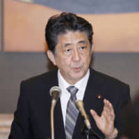 Prime Minister Shinzo Abe speaks during a news conference in Nagasaki on Friday. | KYODO