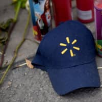 A Walmart hat sits at a memorial three days after a mass shooting at a Walmart store in El Paso, Texas, Tuesday. | REUTERS