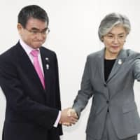 Foreign Minister Taro Kono meets with South Korean Foreign Minister Kang Kyung-wha on the sidelines of the Association of Southeast Asian Nations meeting in Bangkok on Thursday. | KYODO