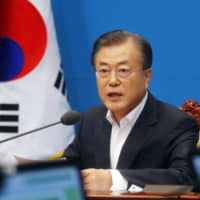 South Korean President Moon Jae-in speaks during an emergency cabinet meeting at the presidential Blue House in Seoul, Friday. Moon has vowed stern countermeasures against Japan's decision to downgrade its trade status, which he described as a deliberate attempt to contain South Korea's economic growth and a 'selfish' act that would damage global supply chains. | AP