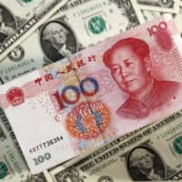 China fuels fears of currency war by setting weak yuan target rate