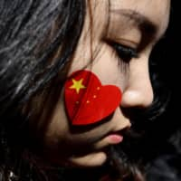 A pro-China activist participates in a march against the Hong Kong protests in Sydney on Saturday. | AFP-JIJI