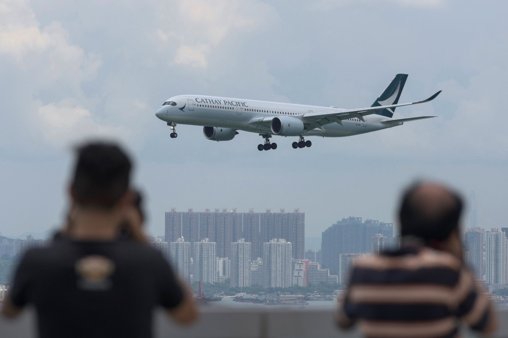 Hong Kong's flag carrier Cathay Pacific Airways Ltd. has flown headlong into a political storm thrown up by the city's swirling pro-democracy protests, as Beijing turns the screws on any company deemed sympathetic to the movement. | AFP-JIJI