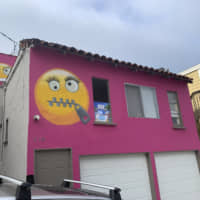 Neighbors frown at 'bullying' emoji on California house