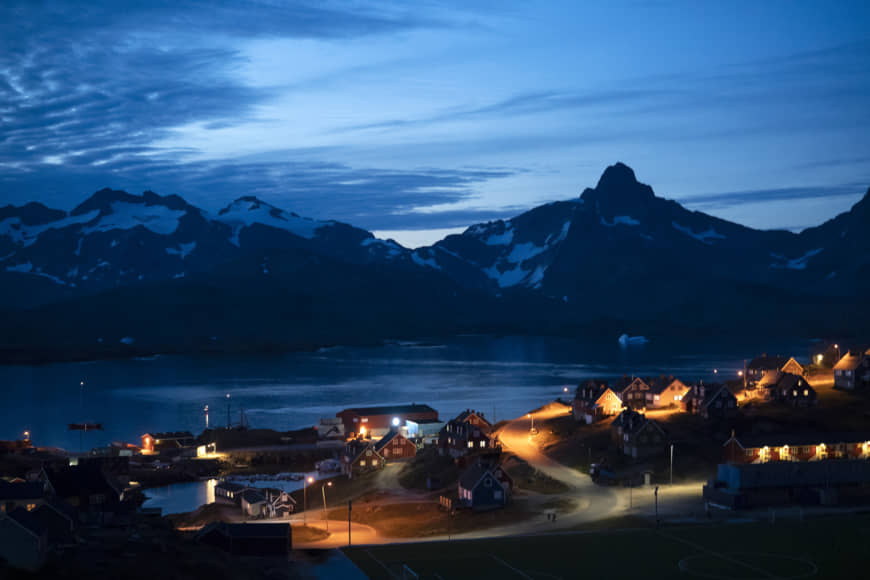 Homes are illuminated after the sunset in Tasiilaq, Greenland, Friday. | AP