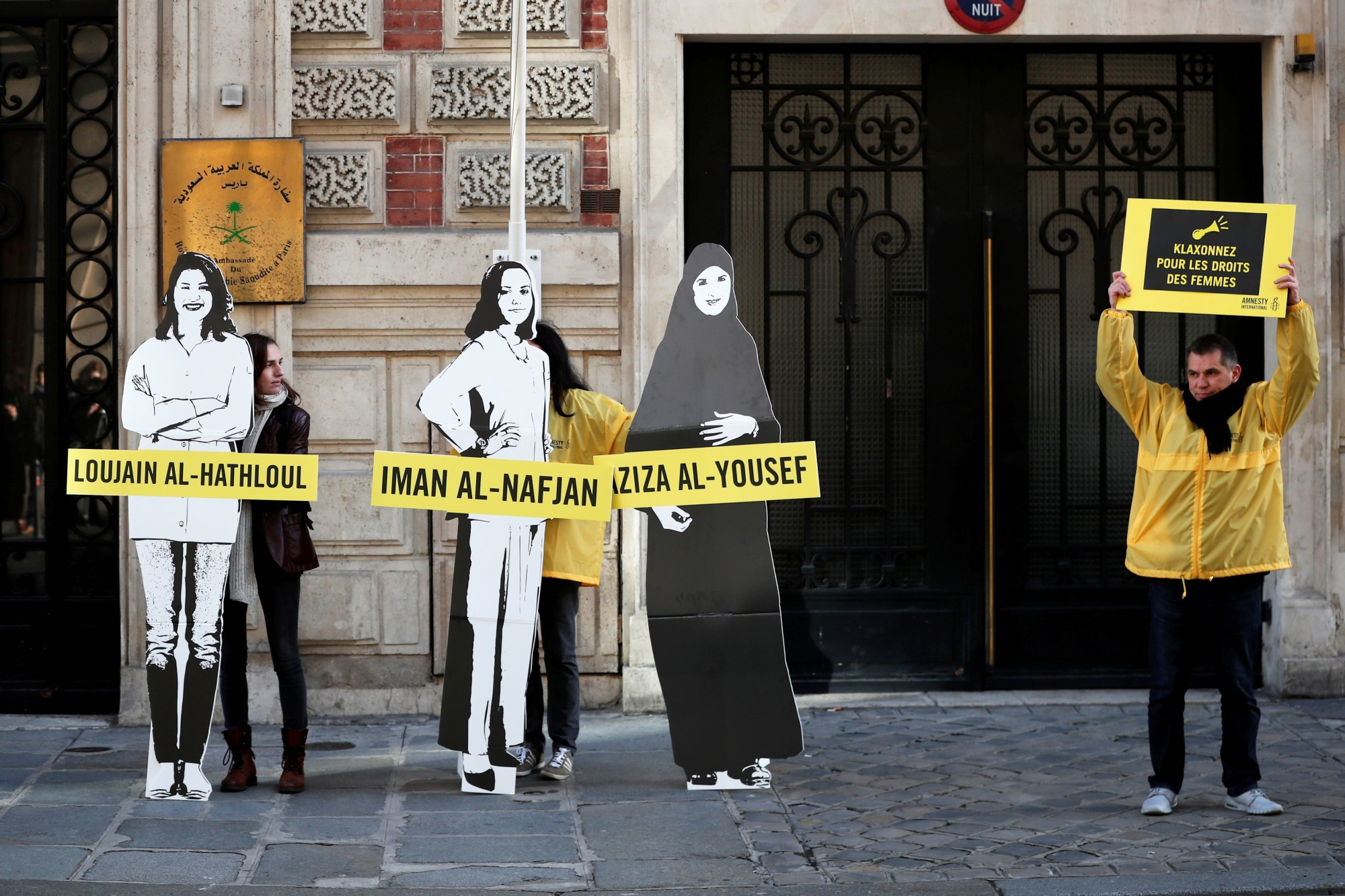 Demonstrators from Amnesty International stage a protest on International Women's day to urge Saudi authorities to release jailed women's rights activists Loujain al-Hathloul, Eman al-Nafjan and Aziza al-Yousef, outside the Saudi Arabian Embassy in Paris in March. | REUTERS