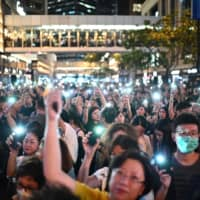 Thousands of Hong Kong civil servants rally peacefully behind protesters as wave of demonstrations looms