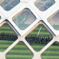 Chinese soldiers march in formation in a stadium of the Shenzhen Bay Sports Center in Shenzhen across the bay from Hong Kong Wednesday. | REUTERS