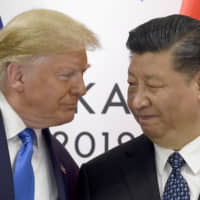 President Donald Trump (left) meets with Chinese President Xi Jinping during a meeting on the sidelines of the G-20 summit in Osaka June 29. Trump is prioritizing China trade negotiations over defending the Hong Kong protesters. This contrasts with the stance normally taken by his White House predecessors, who would use such a flashpoint as a moment to espouse an American commitment to democratic values. | AP