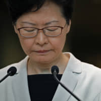 Hong Kong Chief Executive Carrie Lam pauses during a news conference in the city on Tuesday. | AP