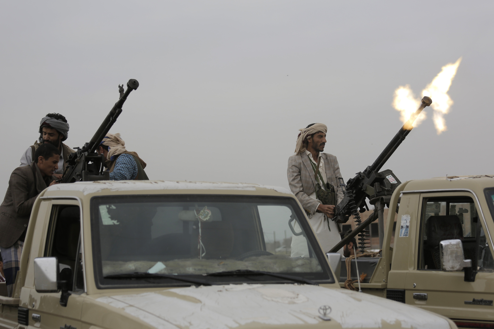 A Houthi rebel fighter fires in the air during a gathering aimed at mobilizing more fighters for their movement, in Sanaa, Thursda. The conflict in Yemen began with the 2014 takeover of Sanaa by the Houthis, who drove out the internationally recognized government. Months later, in March 2015, a Saudi-led coalition launched its air campaign to prevent the rebels from overrunning the country's south.   AP