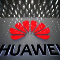 A Huawei company logo is pictured at Shenzhen International Airport in Shenzhen, China, on July 22.