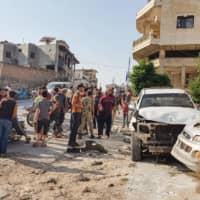 Cease-fire gives wary Syrians in Idlib respite from airstrikes but shelling continues