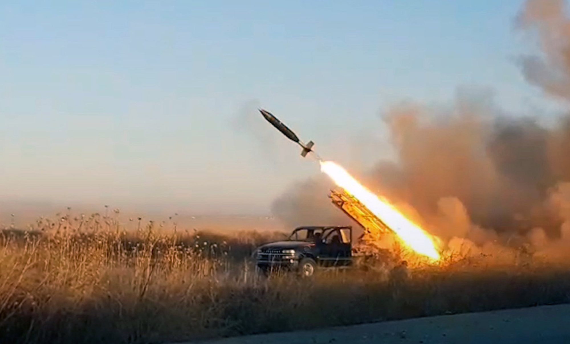 This photo provided by the Ibaa News Agency, the media arm of al-Qaida-linked Hayat Tahrir al-Sham militant group in Syria, purports to show a missile fired by the militant group against Syrian government forces position in Idlib province, Syria, Tuesday, | IBAA NEWS AGENCY / VIA AP