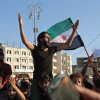 Syrians demonstrate against Russia's interference in their town of Khan Sheikhun, in the rebel-held city of Idlib in northwestern Syria on Tuesday. | AFP-JIJI