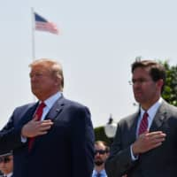 U.S. President Donald Trump attends a welcoming ceremony for newly appointed Secretary of Defense Mark Esper at the Pentagon on July 25.   AFP-JIJI