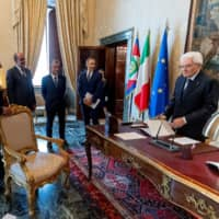 Italy's President Sergio Mattarella is seen inside his office shortly before consultations on the political crisis in Rome on Wednesday. | VIA REUTERS