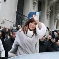 Former Argentine President Cristina Fernandez de Kirchner leaves a building after a meeting with presidential candidate Alberto Fernandez, in Buenos Aires Monday.   REUTERS