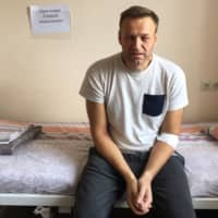 Russia's jailed opposition leader Alexei Navalny sitts on a hospital bed in Moscow Monday, when he said he might have been 'poisoned' in his prison cell amid a crackdown on anti-Kremlin protesters.   HANDOUT / NAVALNY.COM / VIA AFP-JIJI