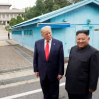 U.S. President Donald Trump meets with North Korean leader Kim Jong Un at the Demilitarized Zone, which separates the two Koreas, in Panmunjom, South Korea, on June 30. | REUTERS
