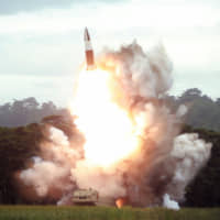 North Korea test-fires a new weapon, presumed to be a short-range ballistic missile, at an undisclosed location on Aug. 16.   KCNA /KNS / VIA AFP-JIJI