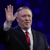U.S. Secretary of State Mike Pompeo waves to the crowd before giving a speech in Indianapolis on Tuesday. | AP