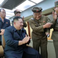 North Korean leader Kim Jong Un oversees the test-firing of a new weapon in this undated photo released Saturday.   KCNA / VIA REUTERS