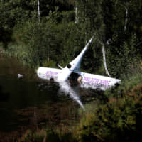 Pair safe after Norway's first electric plane crash-lands on lake