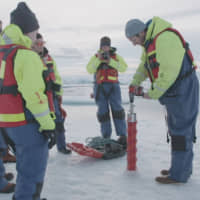 Chief Scientist for the U.S.-led Northwest Passage Project Dr. Brice Loose drills an ice core in the Canadian Arctic during of an 18-day icebreaker expedition that took place in July and August in a still image taken from a handout video obtained Wednesday. | NORTHWEST PASSAGE PROJECT / CAMERA: DUNCAN CLARK VIA REUTERS