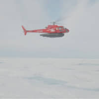 A research helicopter of the U.S.-led Northwest Passage Project flies over the Canadian Arctic during an 18-day icebreaker expedition that took place in July and August in a still image taken from a handout video obtained Wednesday. | NORTHWEST PASSAGE PROJECT / CAMERA: DUNCAN CLARK / VIA REUTERS