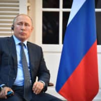 Russian President Vladimir Putin looks on during his meeting with his French counterpart at the French president's summer retreat at the Bregancon fortress on the Mediterranean coast, near the village of Bormes-les-Mimosas, southern France, on Monday. | AFP-JIJI