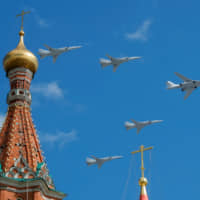 Russian army Tupolev Tu-160 (right) and Tupolev Tu-22M3 fly in formation over St. Basil's Cathedral during the rehearsal for the Victory Day parade in Moscow in May.   REUTERS