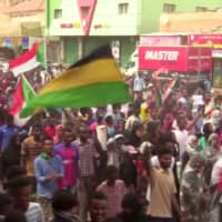 People demonstrate against the killing of protesting children, who were shot dead when security forces broke up a student protest in Khartoum, Thursday in this still image taken from video. | REUTERS TV / VIA REUTERS