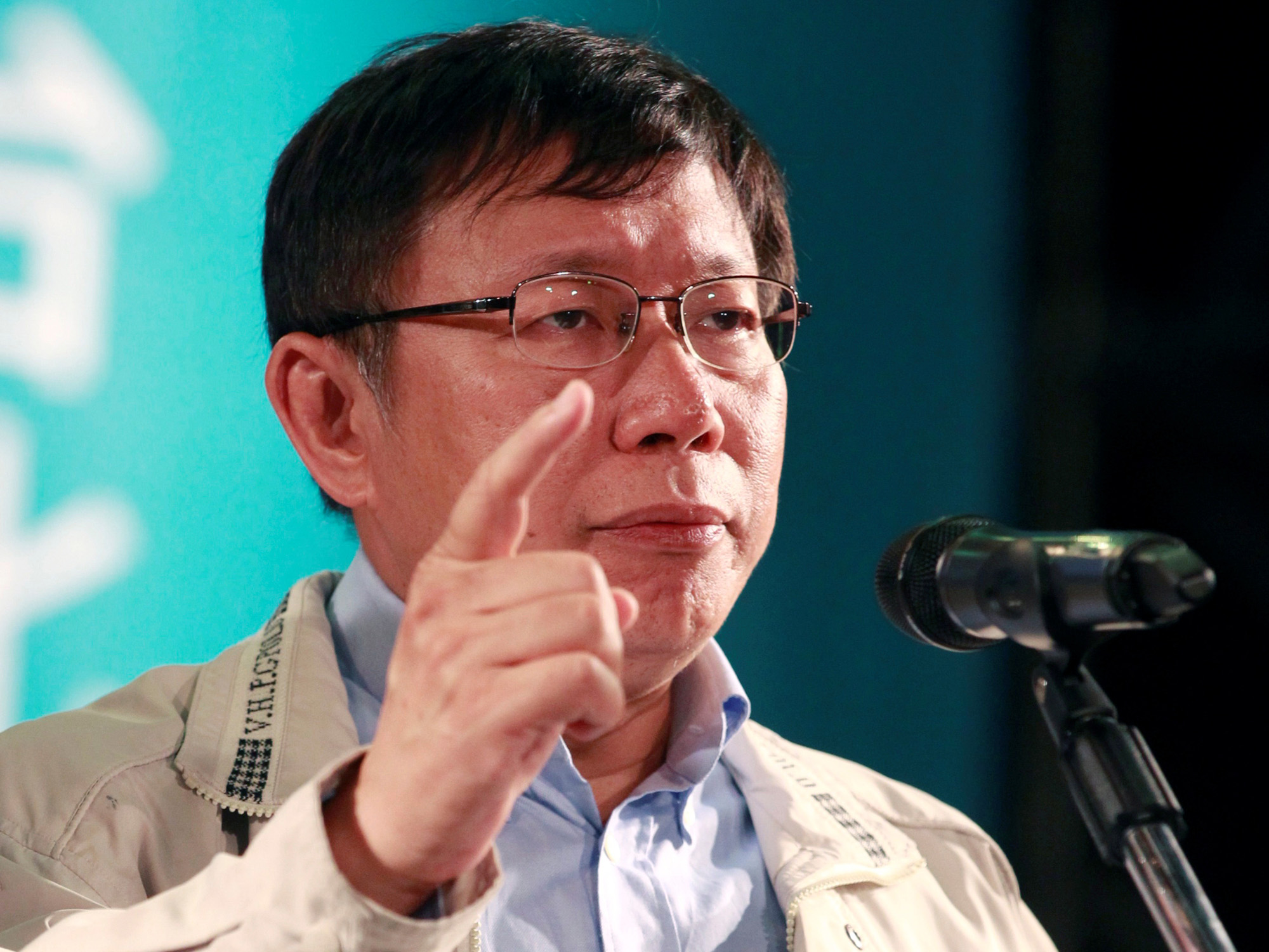 Taipei mayoral candidate Ko Wen-je speaks after winning an election at his campaign headquarters in Taipei in November 2014. | REUTERS