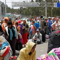 Venezuelan migrants flood into Ecuador from Colombia ahead of new visa curbs