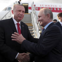 Russian President Vladimir Putin (right) shakes hands with Turkish President Recep Tayyip Erdogan prior to his departure from Zhukovsky, outside Moscow, Tuesday. | PRESIDENTIAL PRESS SERVICE / VIA AP