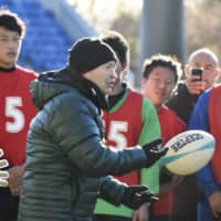 Eddie Jones, former Japan coach and current England coach, holds a rugby clinic for high school students in Kumagaya, Saitama Prefecture, in December 2018. | KYODO