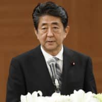 Prime Minister Shinzo Abe addresses reporters on Tuesday in Hiroshima. | KYODO