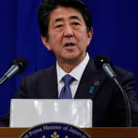 Prime Minister Shinzo Abe speaks at a news conference in Biarritz, France, on Monday.   AFP-JIJI