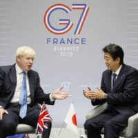 British Prime Minister Boris Johnson and Prime Minister Shinzo Abe hold talks in Biarritz, France, on Monday on the sidelines of the Group of Seven summit.  | KYODO